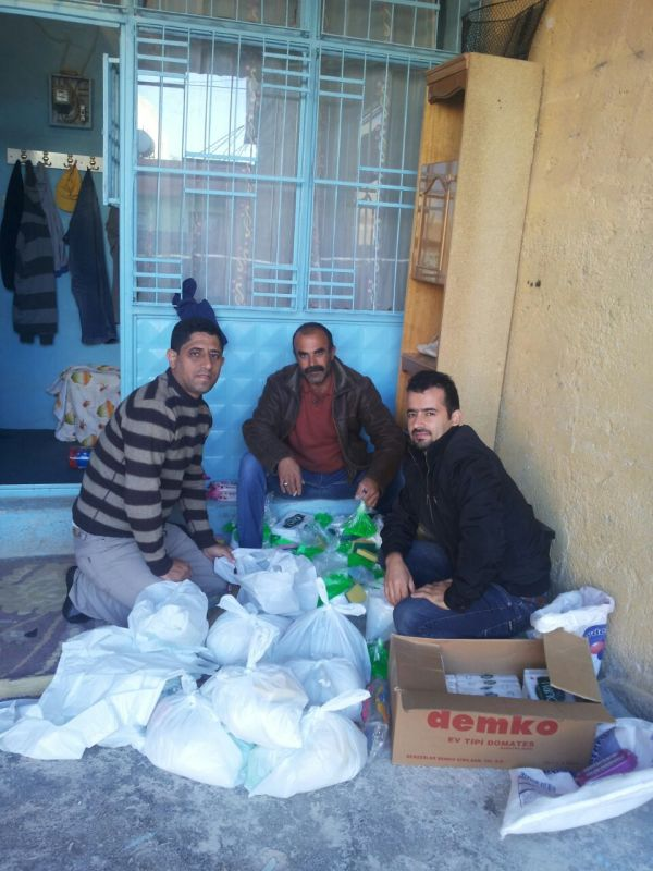 Local Believers Helping Nihad Pack up Food Aid