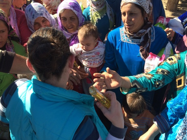 Pauline giving out Hygiene Products to Refugee Women